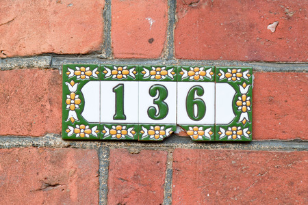 green house: House number 136 sign Stock Photo