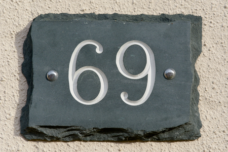inform information: House number 69 sign Stock Photo