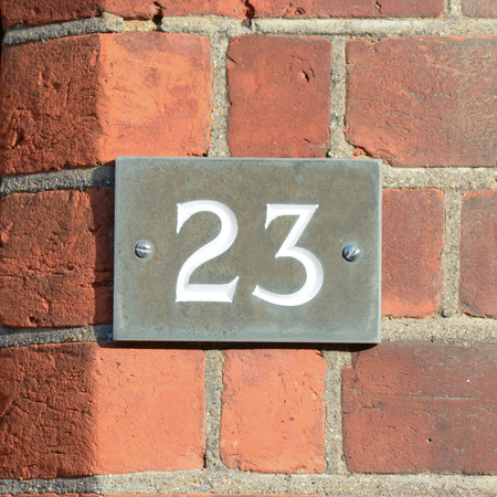 inform information: House number 23 sign