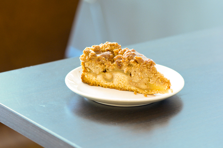 apple crumble: Slice of apple crumble on plate Stock Photo
