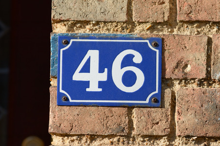 inform information: House number 46 sign on wall
