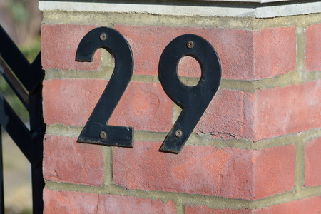 inform information: House number 29 sign on wall