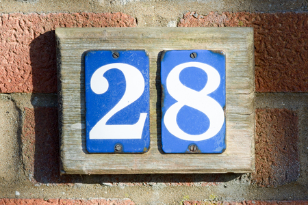 inform information: House number 28 sign on wall