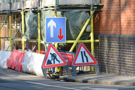 danger ahead: Road traffic warning signs for drivers and pedestrians Stock Photo