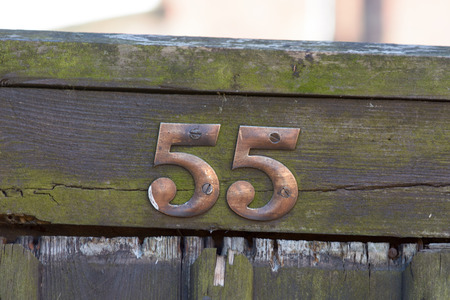 inform information: House number 55 sign on gate