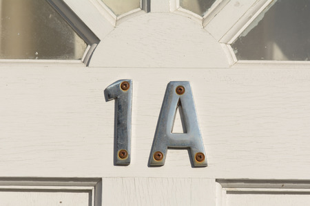 inform information: House number 1a sign Stock Photo