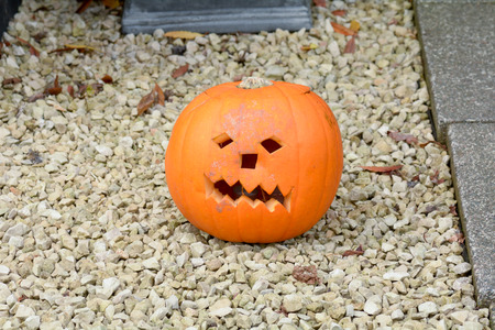 into: Face carved into pumpkin for Halloween