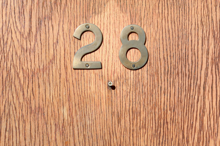 inform information: House number 28 sign on wooden door