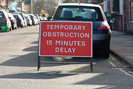 obstruction: Temporary Obstruction sign in road Stock Photo