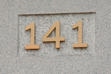 inform information: House number 141 sign Stock Photo