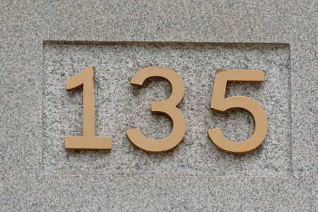 inform information: House number 135 sign Stock Photo