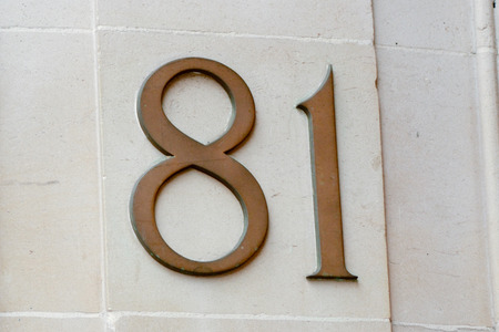 81: House number 81 sign