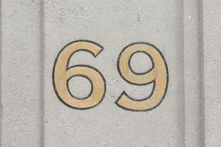 inform information: House number  69 painted sign