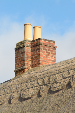 thatched cottage: Chimney Stack on roof of thatched cottage Stock Photo