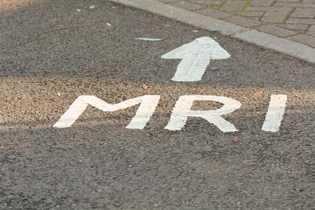 resonating: MRI this way sign on tarmac at hospital