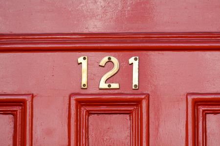 House number 121 sign on door