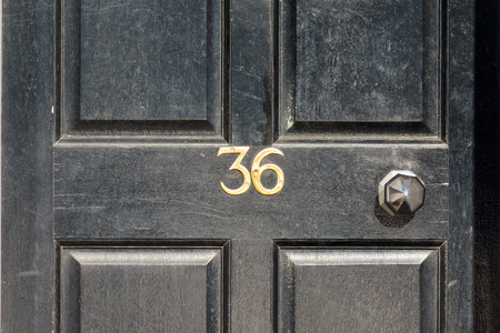 number 36: House number 36 sign on door Stock Photo
