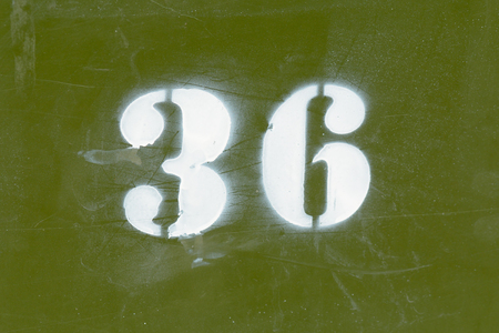 number 36: House number 36 painted sign