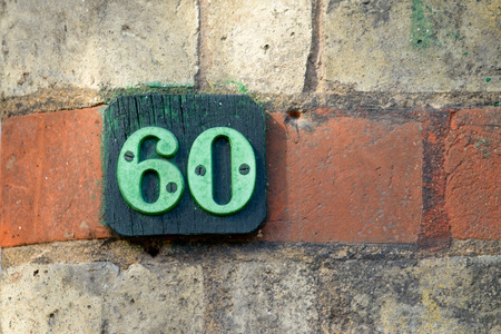 60: House number 60 sign