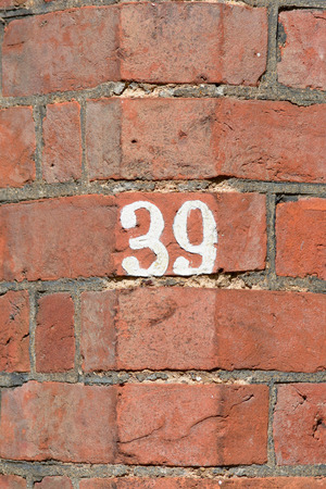inform information: House number 39 painted sign