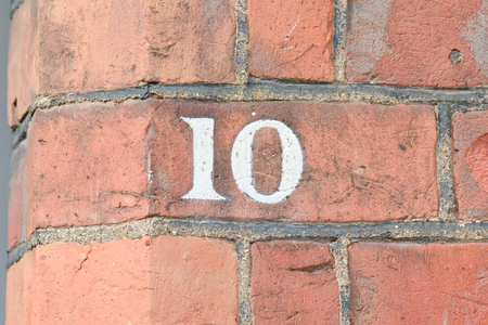 number 10: House number 10 painted sign on wall Stock Photo