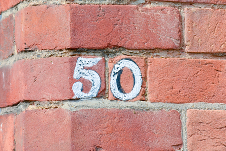 50 number: House number 50 painted sign on wall