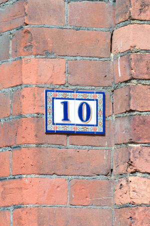 number 10: House number 10 sign on wall