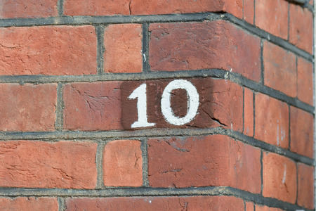number 10: House number 10 painted sign
