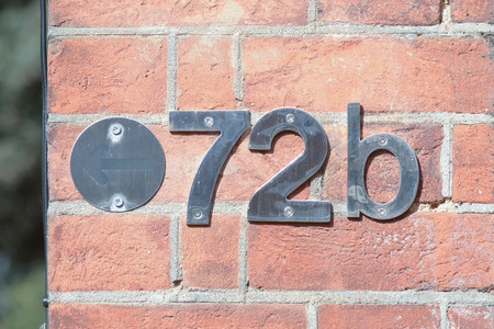 inform information: House number 72B sign Stock Photo