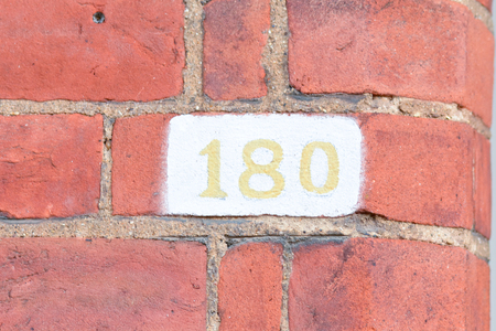 inform information: House number 180 painted sign