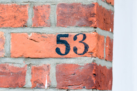 inform information: House number 53 painted sign