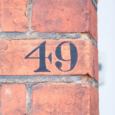 inform information: House number 49 painted sign Stock Photo