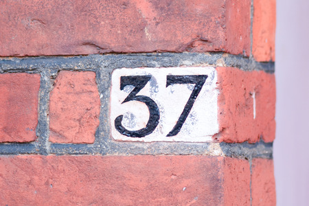 inform information: House number 37 painted sign