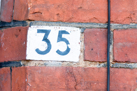 35: House number 35 painted sign Stock Photo