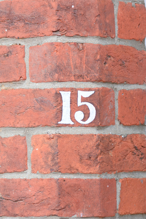 number 15: House number 15 painted sign