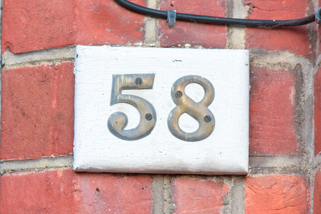 inform information: House number 58 sign