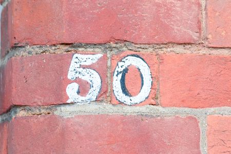 inform information: House number 50 painted sign