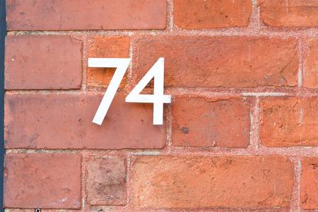 inform information: House number 74 sign