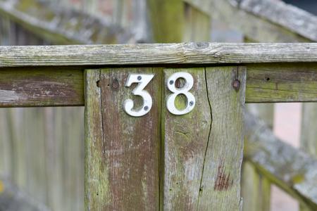inform information: House number 38 sign