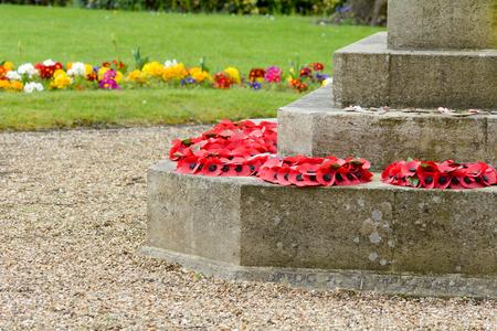 wreaths: Poppy wreaths at base of war memorial