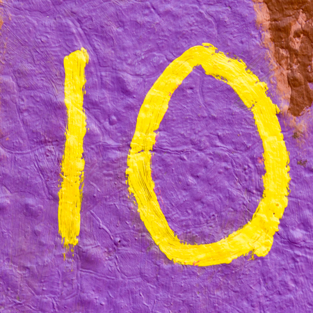 inform information: House number 10 painted sign