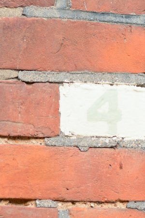 inform information: House number 4 painted sign Stock Photo