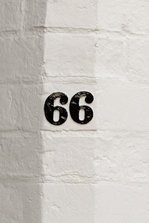 inform information: House number 66 sign