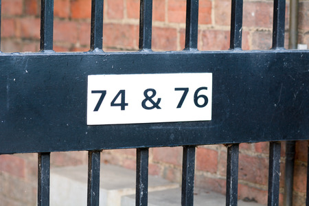 inform information: House number 74 and 76 sign