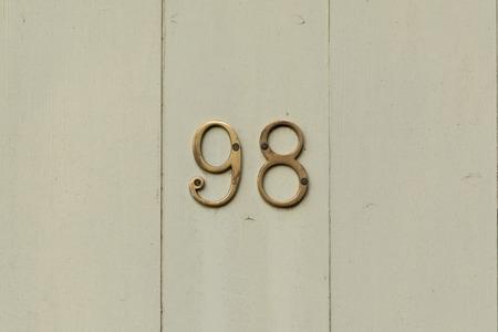 inform information: House number 98 sign