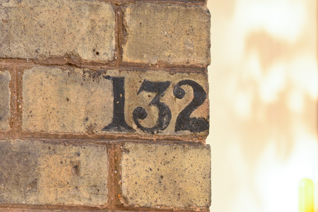 inform information: House number 132 painted sign