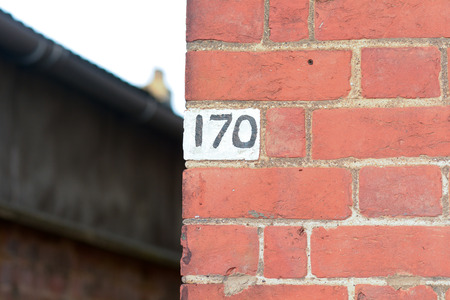 inform information: House number 170 painted sign