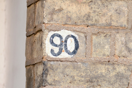 inform information: House number 90 painted sign