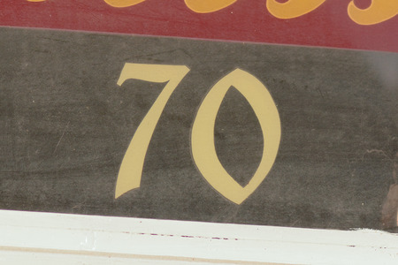 inform information: House number 70 painted sign Stock Photo