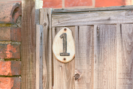 inform information: House number 1 sign on gate Stock Photo